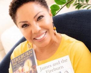Angela holding her two Fireburn books